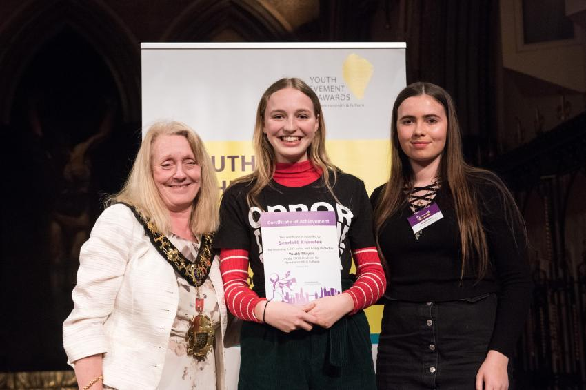 H&F Youth Mayor Scarlett Knowles being presented with a Youth Achievement Award certificate at a ceremony in 2019