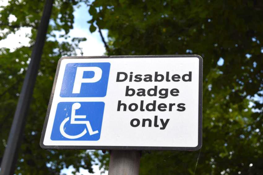 Disabled bade holders only parking sign