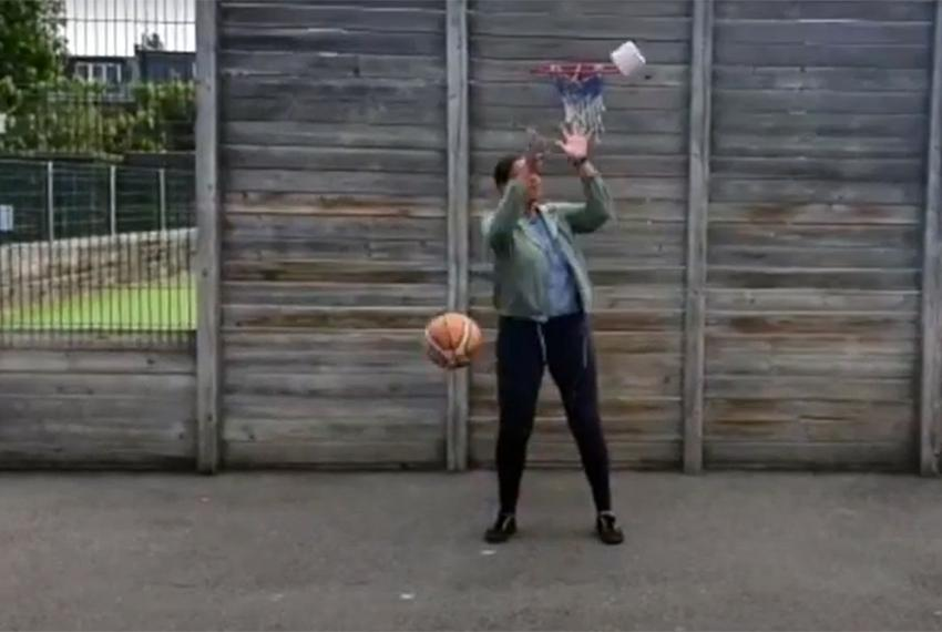 Sir John Lillie teacher in a playground catching a basketball and a toilet roll