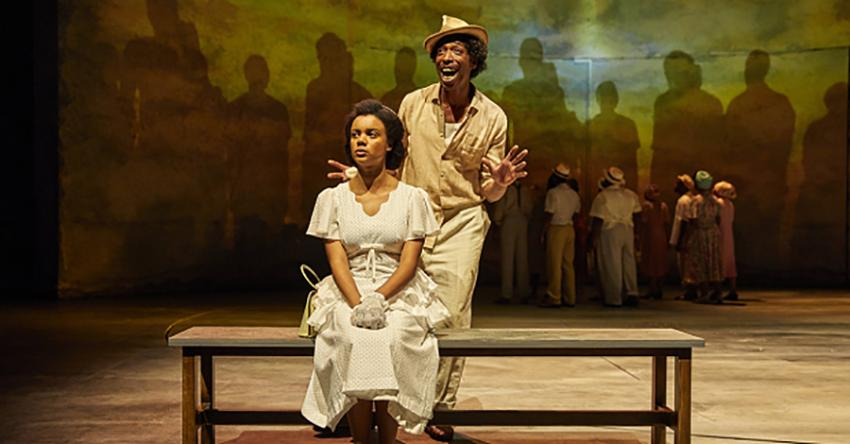 Actors on stage at the National Theatre performing Small Island