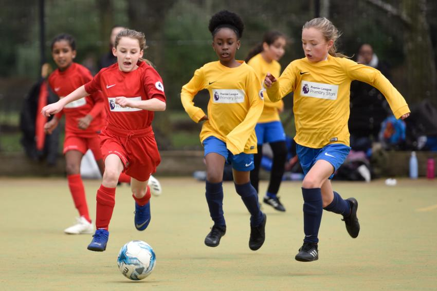 St John's Walham Green girls football team in red shirts