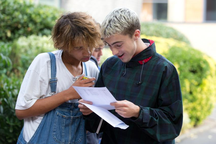 Delighted pupils compare results