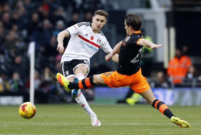 Fulham's Tom Cairney in action with Sheffield Wednesday's Sam Hutchinson