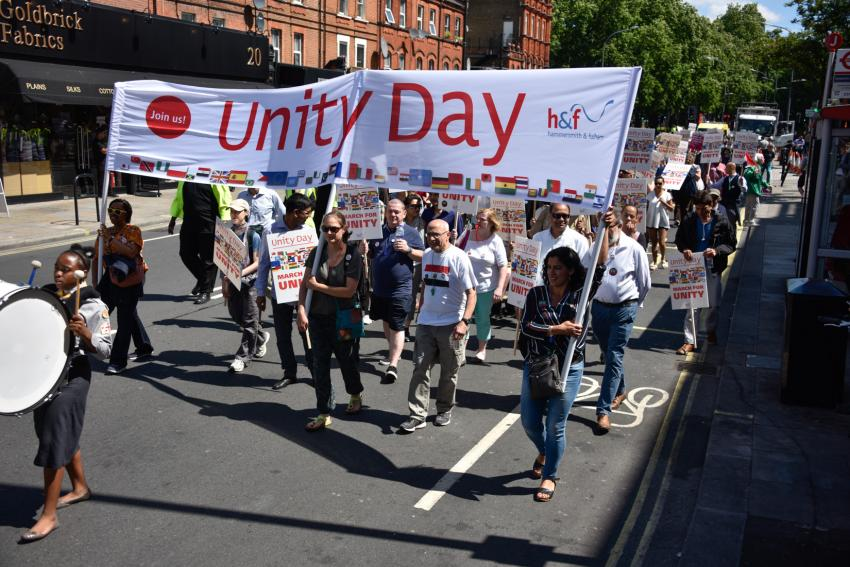 People marching on the trseets of Hammersmith & Fulham to celebrate Unity Day