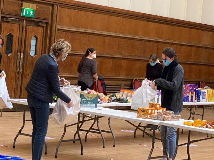 Volunteers packing up food parcels for the shielded at Hammersmith Town Hall