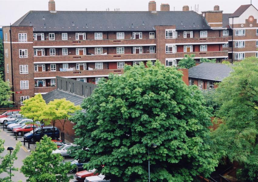 Buildings on the White City Estate with trees in the foreground