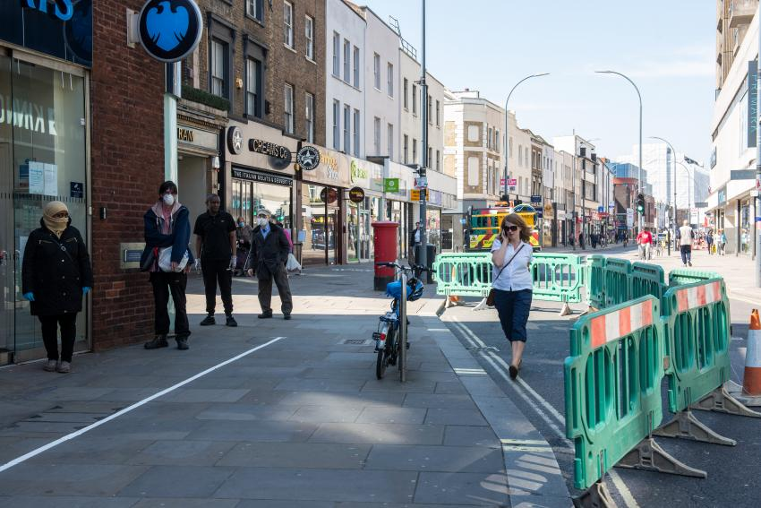 Green barriers on King Street in Hammersmith to mark out wider pavements for pedestrians