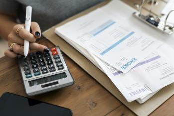 Calculator and paperwork on an office desk