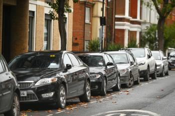Row of cars parked along the kerbside on a street in Hammersmith & Fulham