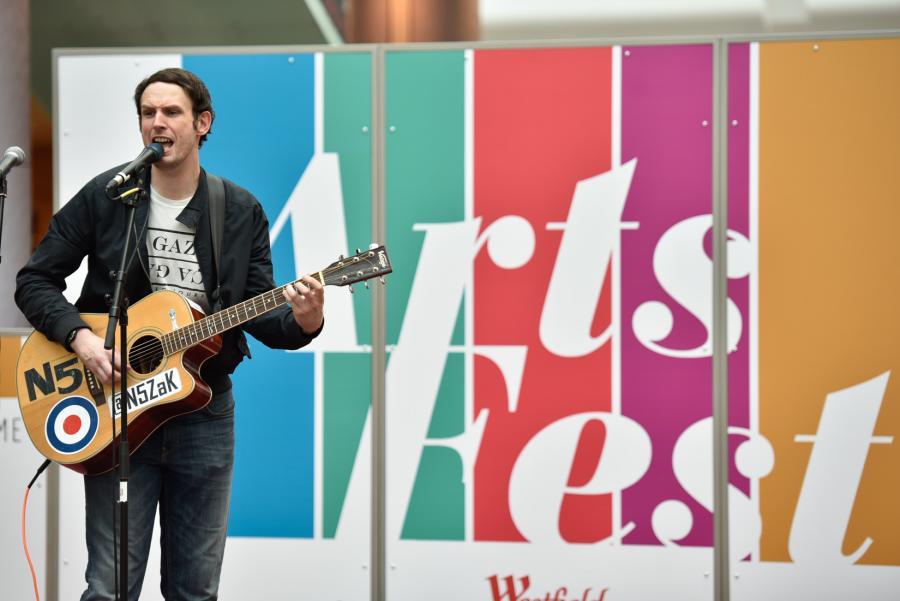 Singer songwriter performing at ArtsFest
