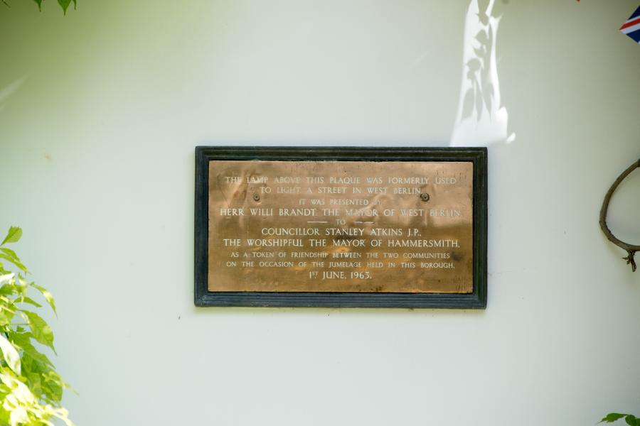 Dedication plaque on the wall of Westcott Lodge in Furnivall Gardens