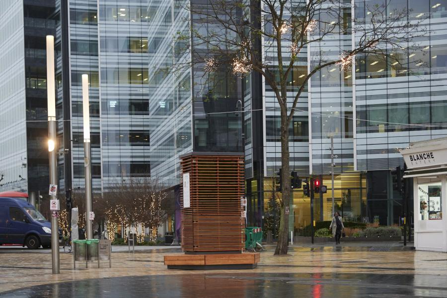 City Tree structure in the centre of Lyric Square, Hammersmith with tall office buildings in the background