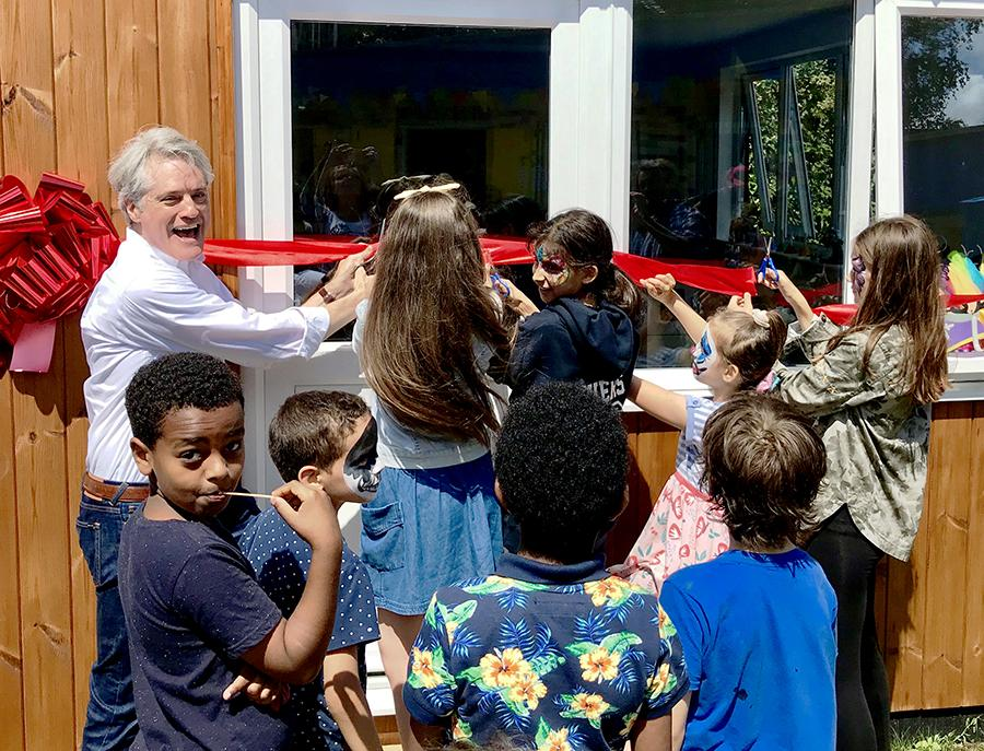Cllr Ben Coleman and kids cutting the ribbon at the opening of the Sands End social shack