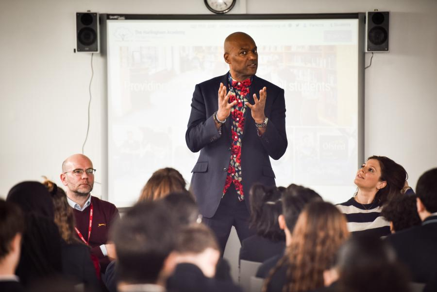 Actor Colin Salmon tallking to Hurlingham Academy pupils