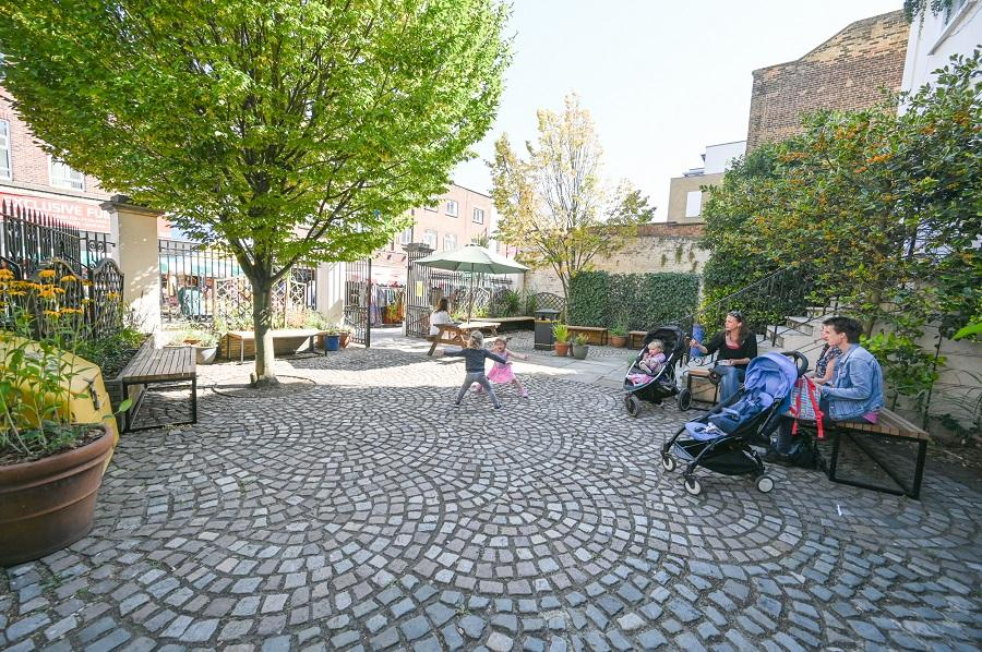 Families relaxing in the Crowther CommunityGarden