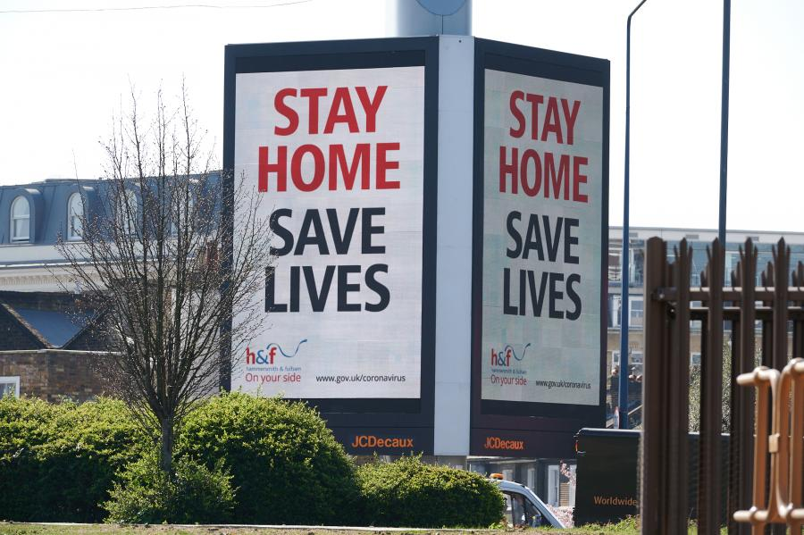 Stay Home Save Lives message displayed twice on a digital advertising board