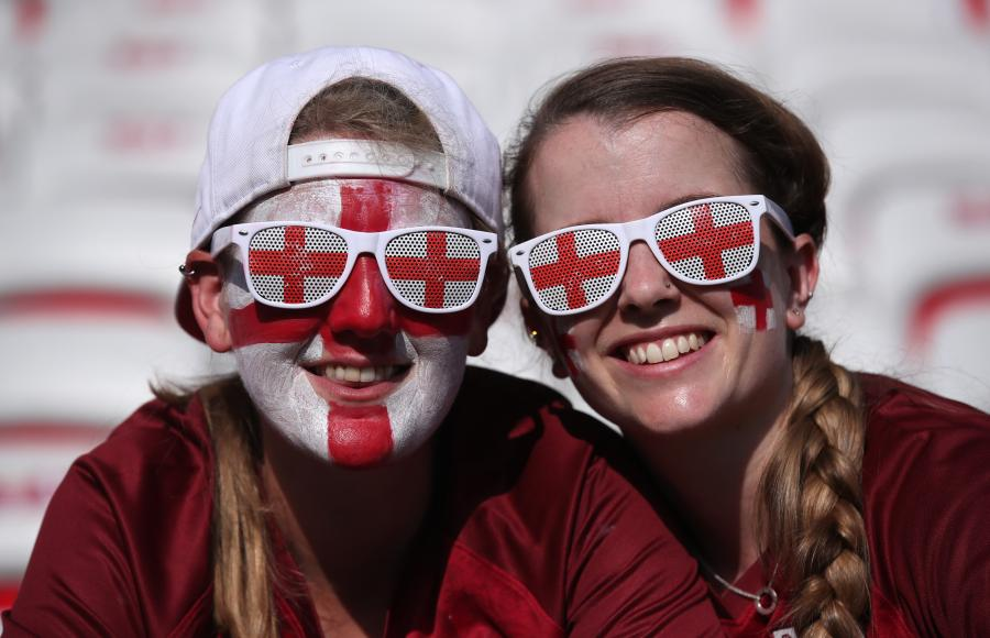 England Women fans with St George flag painted on their faces and matching sunglasses