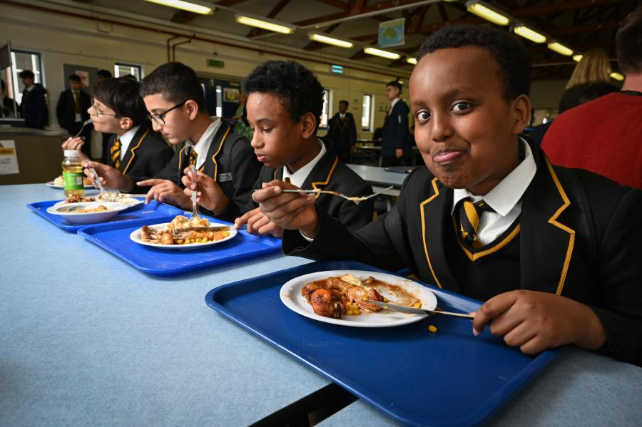 Group of students eating lunch at Fulham College Boys' School