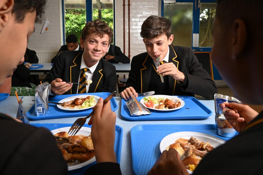 Fulham College Boys' School students eating lunch