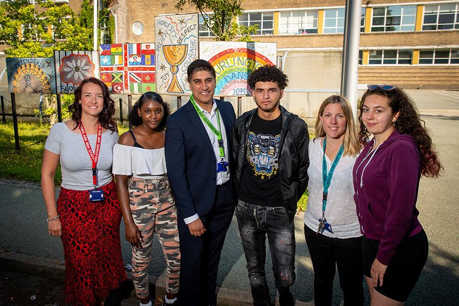 Teachers and students at Burlington Danes Academy after GCSE success