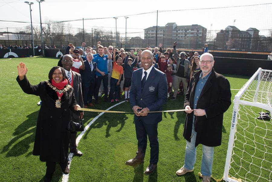 QPR legend Les Ferdinand cuts the ribbon to open the new football facility in White City