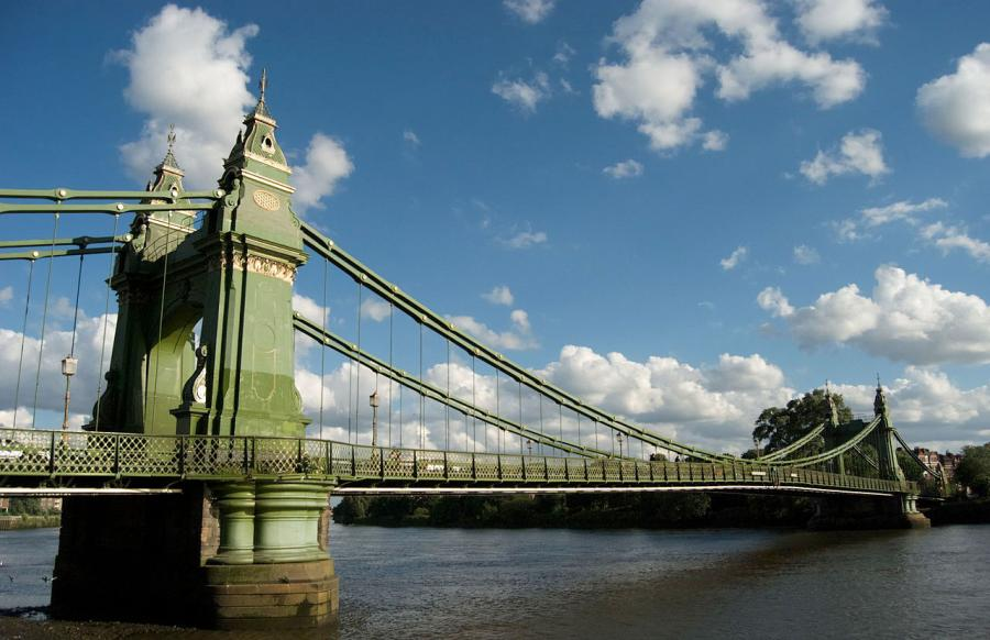 Hammersmith Bridge spanning the river Thames supported by its two pedestals