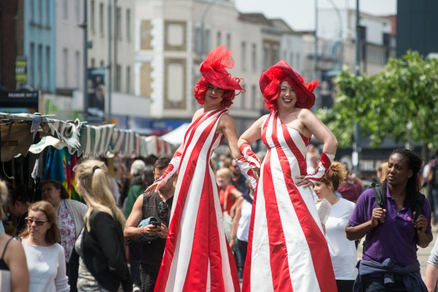Stilt walkers at Hammersmith Market