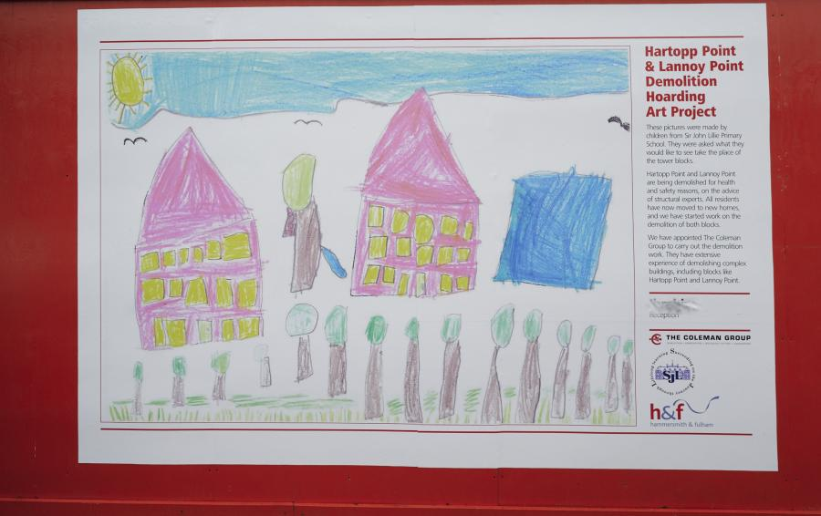 Poster of a child's drawing fastened to red building site hoardings