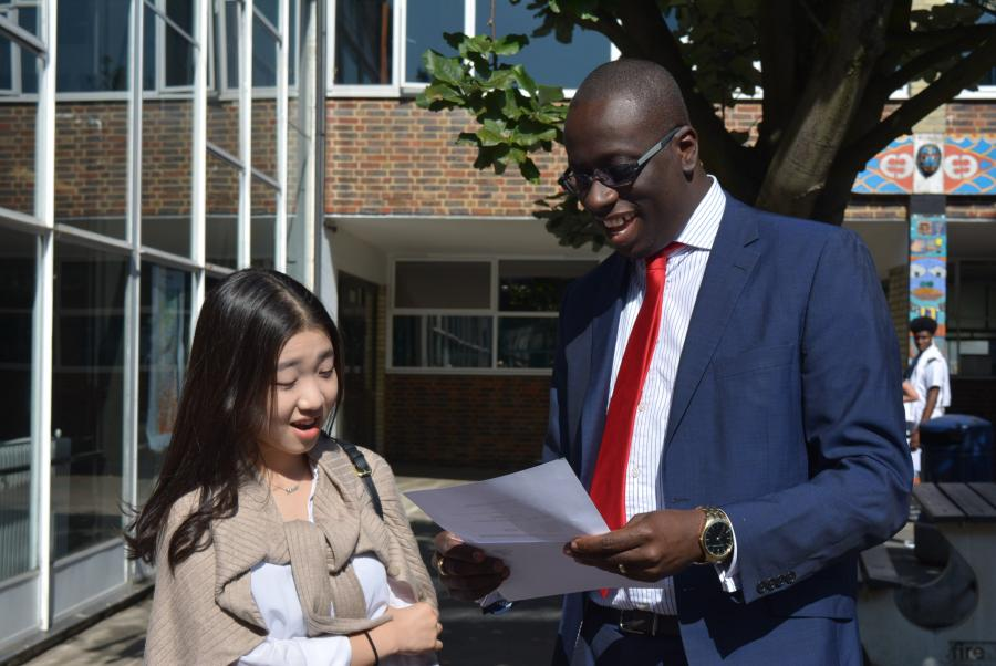 Hurlingham Academy principal and student looking at GCSE results