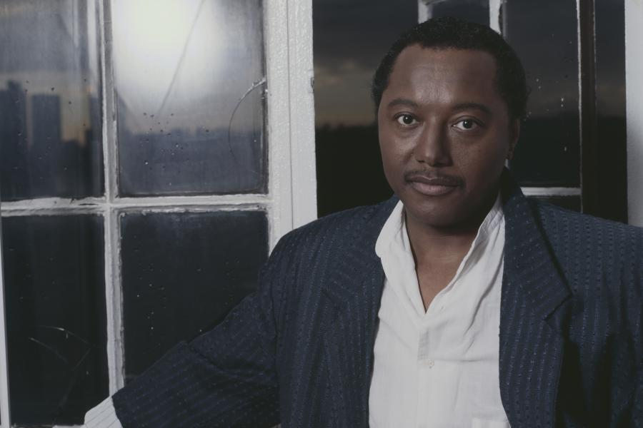 Labi Siffre leaning against window sill