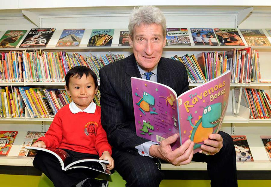 Brackenbury Primary pupil Benjamin Chang reads books with journalist Jeremy Paxman on opening day of Shepherds Bush Library at Westfield
