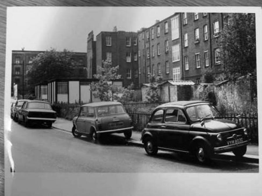 Monochrome view of temporary homes and cars on a road
