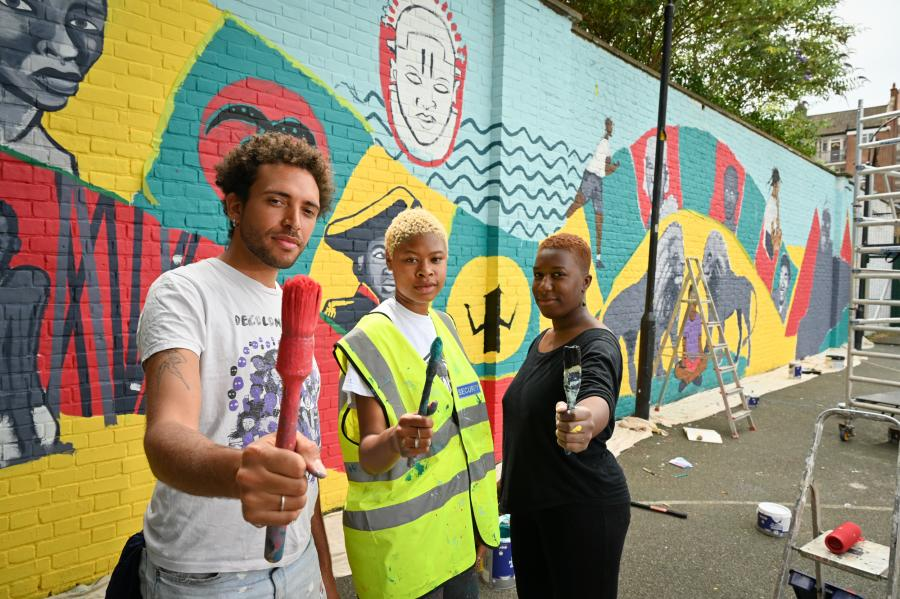 Mural artists Jacob V Joyce, Sola Olulode and Buki Bayode