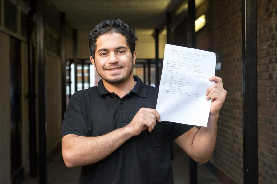 Fulham College Boys' student, Mohammed Abuqarnar with his GCSE results