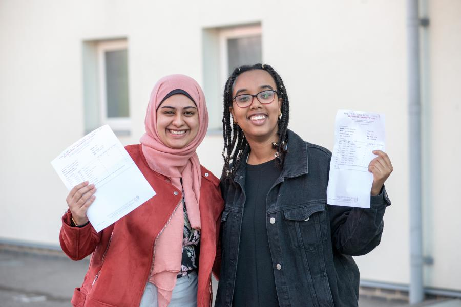 Fulham Cross Girls students, Amal and Noor, smiling at their GCSE results