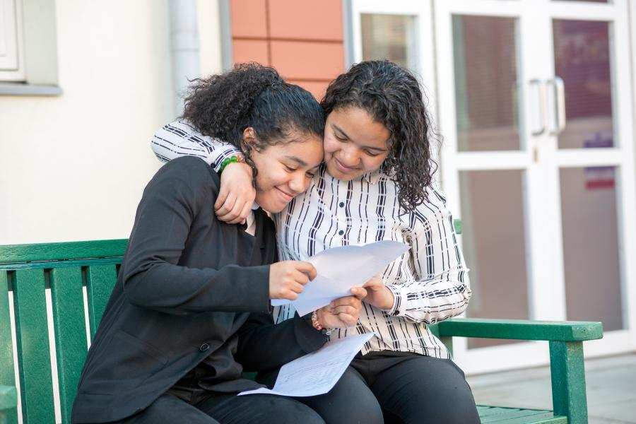 Twin students at Fulham Cross Girls school embrace as they read GCSE results