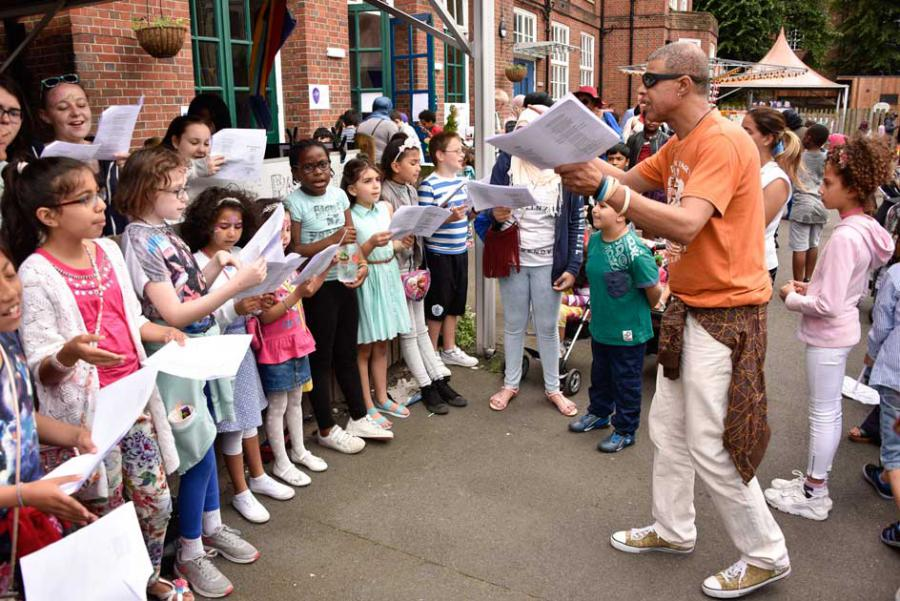 Music teacher Colin O'Dell-Athill leads pupils in song