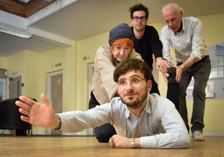 Group of actors rehearsing their roles on the floor of a rehearsal studio