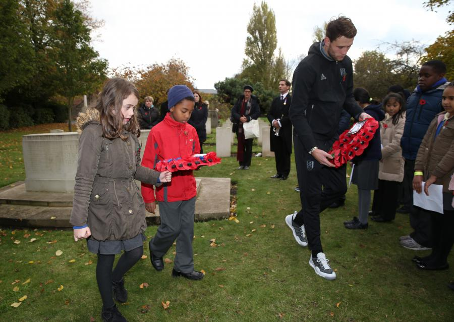 Fulham FC's Marcus Bettinelli lays a wreath