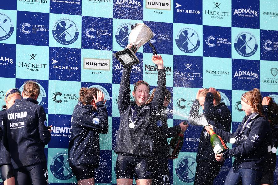 The Oxford crew celebrate with the trophy following their victory during The Cancer Research UK Women's Boat Race