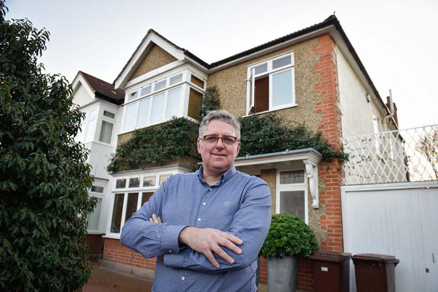 Nigel Walley standing outside his home