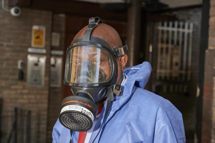 Pest control crew member wearing a breathing mask