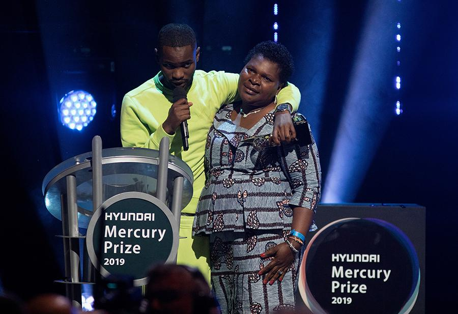 Rapper Dave on stage collecting the 2019 Mercury Music Prize with his mum