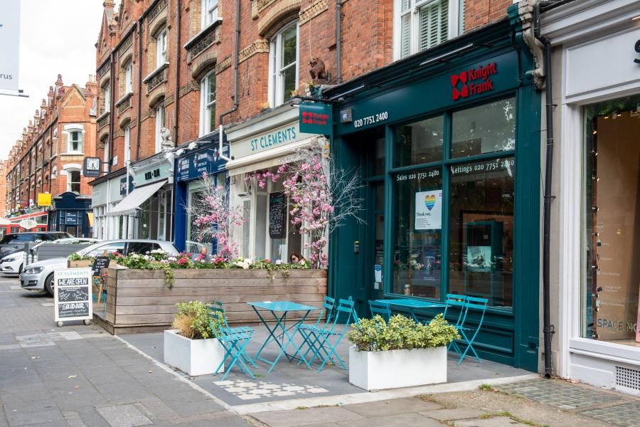 Two neighbouring properties on New Kings Road sharing terrace space for tables and chairs