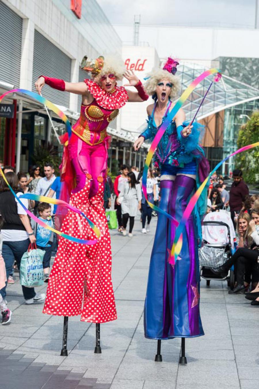 Stilt-walkers take part in the HF ArtsFest finale