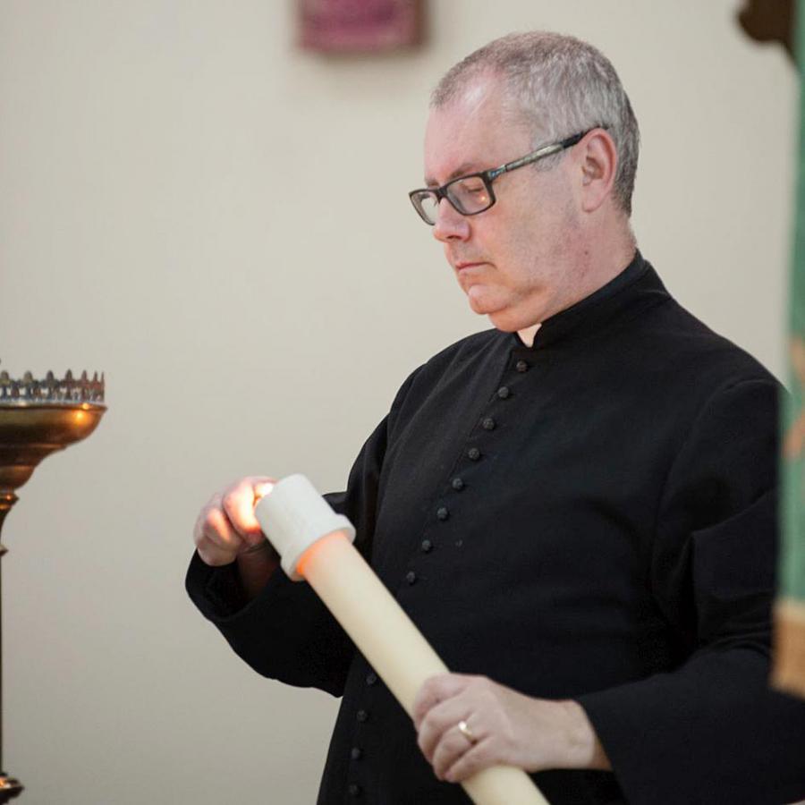 Father Simon Brandes led the service