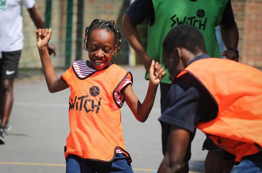 Child playing sports at the 'Switch On Your Happiness' summer festival