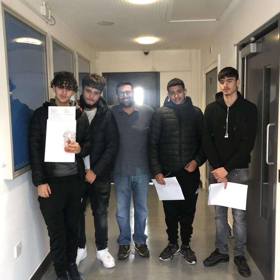Students at The Bridge AP Academy receiving their GCSE results