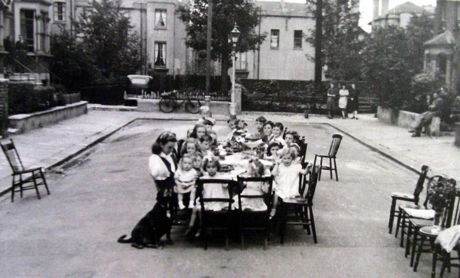 Group pf children sitting around a table for a tea party in Brackenbury Gardens