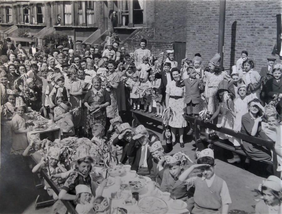 Group of people celebrating VE Day on an unknown street in Hammersmith